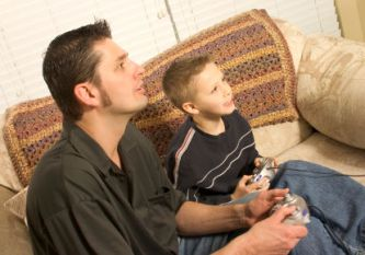father-and-son-playing-videogames